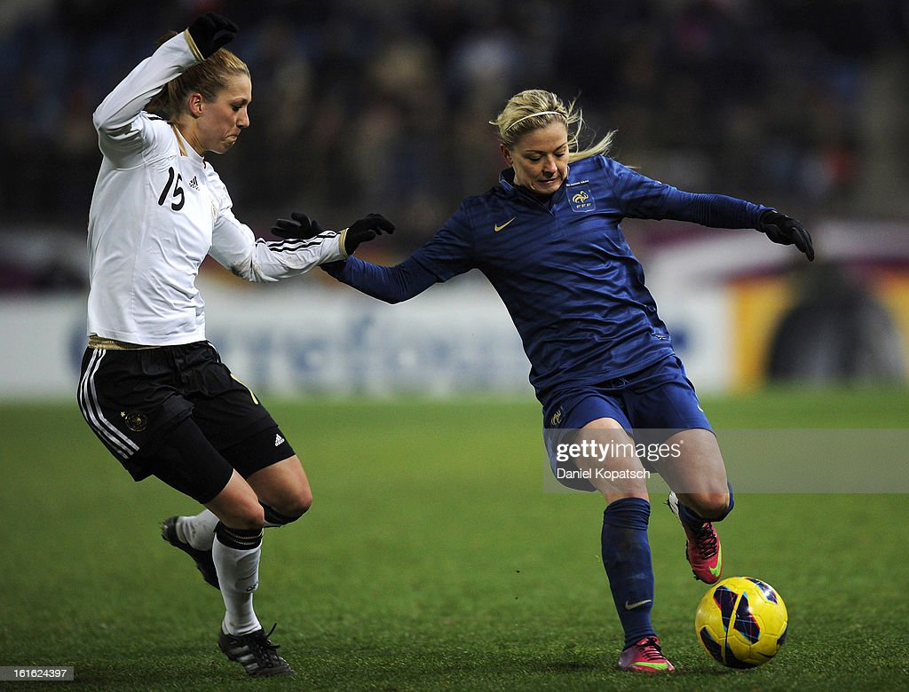 Laure Boulleau of France (R) is challenged by Verena Faisst of Germany during the international friendly match between France and Germany at Stade de la Meinau on February 13, 2013 in Strasbourg, France.