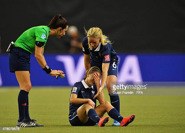 Laure Boulleau of France is helped by Amandine Henry during the FIFA Womens's World Cup round of 16 match between France and Korea at Olympic Stadium...