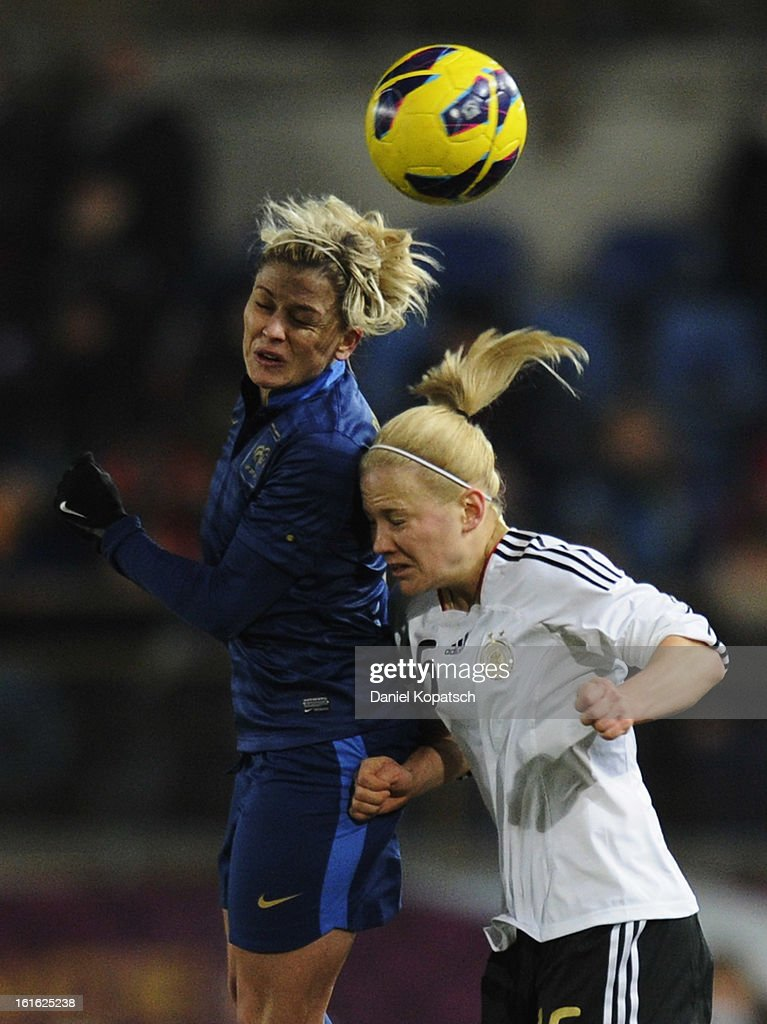 Laure Boulleau of France (L) jumps for a header with Leonie Maier of Germany during the international friendly match between France and Germany at Stade de la Meinau on February 13, 2013 in Strasbourg, France.