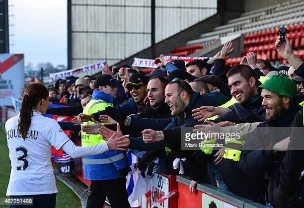 Laure Boulleau of Paris SaintGermain is congratulated by traveling PSG fans during the UEFA Woman's Champions League Quarter Final match between...