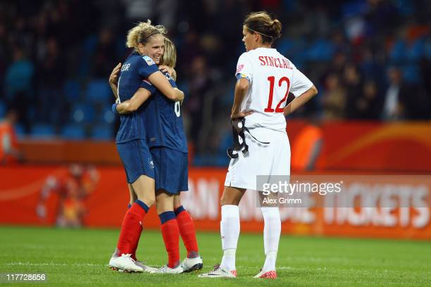 Laure Lepailleur and Sonia Bompastor of France celebrate as Christine Sinclair of Canada reacts after the FIFA Women's World Cup 2011 Group A match...