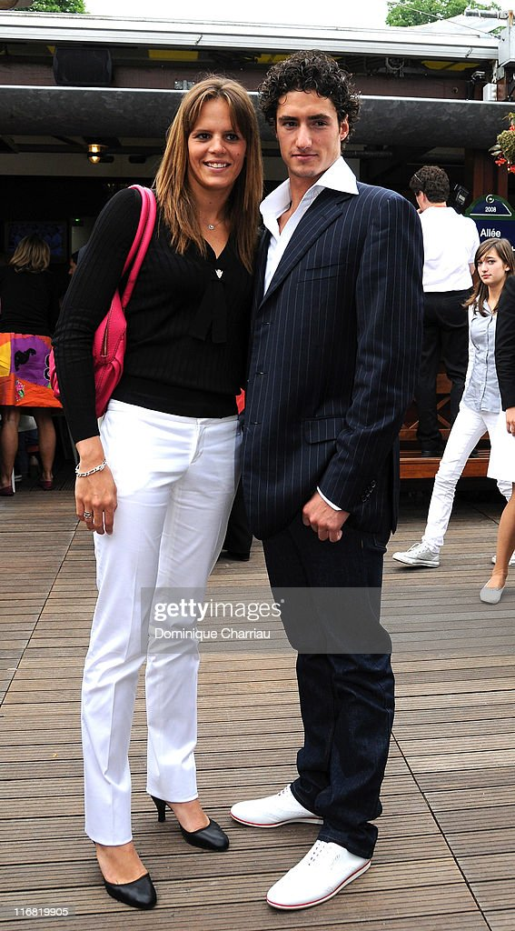 Laure Manaudou and Benjamin Stasiulis attend the 2008 French Open at Roland Garros on June 8 2008 in Paris France