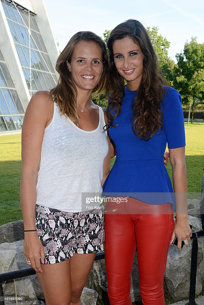 Laure Manaudou and Miss France 2012 Malika Menard attend the 'Laure Manaudou Design' Swimming Suit show at Piscine Billancourt on July 2 2014 in...