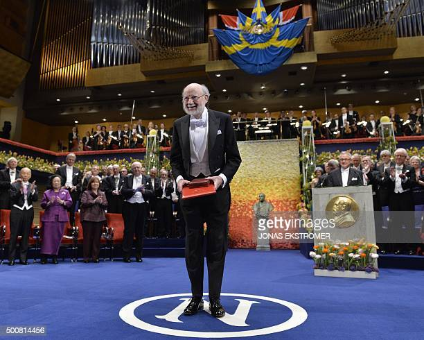 Laureate of the 2015 Nobel Prize in Physiology or Medicine Irish William C Campbell stands on the stage after receiving his medal during the 2015...