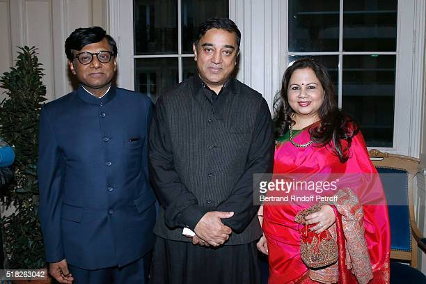Laureate of the Price Henri Langlois Indian actor and director Kamal Haasan standing between Indian Ambassador to Paris Mohan Kumar and his wife Mala...