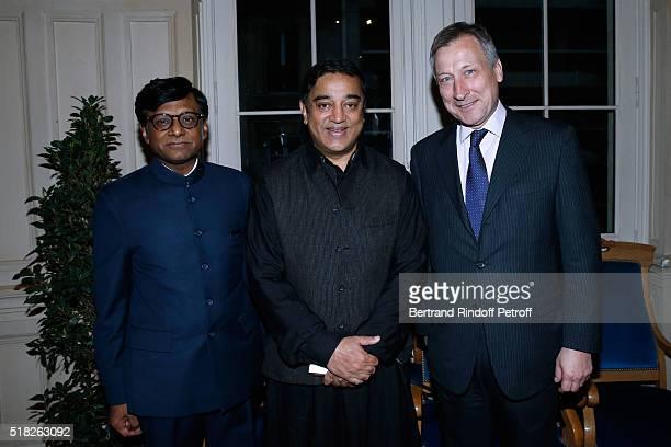 Laureate of the Price Henri Langlois Indian actor and director Kamal Haasan standing between Indian Ambassador to Paris Mohan Kumar and Belgium...