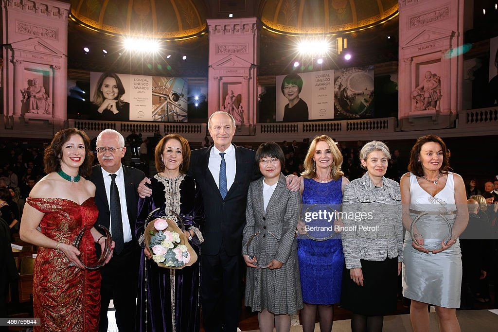 Laureate Professor Molly S. Shoichet (Polymer Chemistry), Acting President of Physical Sciences Jury, Professor Christian Amatore, 2015 Laureate Professor Rajaa Cherkaoui El Moursli (High Energy and Nuclear Physics), Chairman & Chief Executive Officer of L'Oreal and Chairman of the L'Oreal Foundation <a gi-track='captionPersonalityLinkClicked' href=/galleries/search?phrase=Jean-Paul+Agon&family=editorial&specificpeople=675160 ng-click='$event.stopPropagation()'>Jean-Paul Agon</a>, 2015 Laureates Professor Yi Xie (Inorganic Chemistry), Professor Thaisa Storchi Bergmann (Physic and Astronomy), Director-General of UNESCO <a gi-track='captionPersonalityLinkClicked' href=/galleries/search?phrase=Irina+Bokova&family=editorial&specificpeople=6324408 ng-click='$event.stopPropagation()'>Irina Bokova</a> and 2015 Laureate Professor Dame Carol Robinson (Physical Chemistry and Mass Spectrometry) attend the 'L'Oreal-UNESCO Awards 2015 for Women in Science at La Sorbonne on March 18, 2015 in Paris, France.