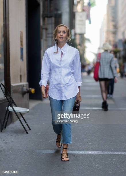 Laurel Pantin wearing white button shirt denim jeans seen in the streets of Manhattan outside Victoria Beckham during New York Fashion Week on...