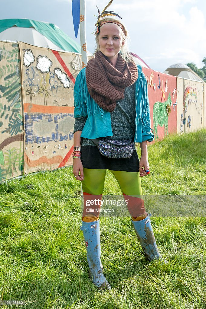 Lauren ,19 ,a carer from Newcastle attends the Glastonbury Festival on day 2 wearing vintage from Urban Outfiters and Hunter wellies at Worthy Farm on June 28, 2014 in Glastonbury, England.