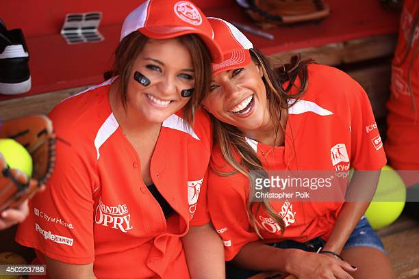 Lauren Alaina and Jana Kramer participate in City of Hope Celebrity Softball Game during the CMA Festival at Greer Stadium on June 7 2014 in...