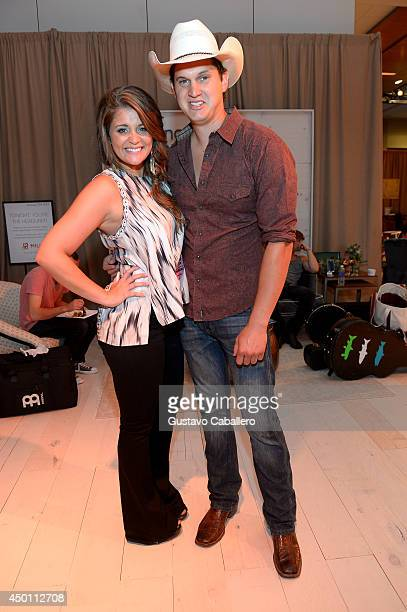 Lauren Alaina and Jon Pardi at the Samsung Galaxy Artist Lounge at the 2014 CMA Music Festival on June 5 2014 in Nashville Tennessee