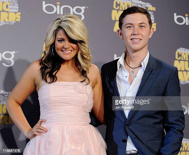 Lauren Alaina and Scotty McCreery pose in the press room at the 2011 CMT Music Awards at the Bridgestone Arena on June 8 2011 in Nashville Tennessee
