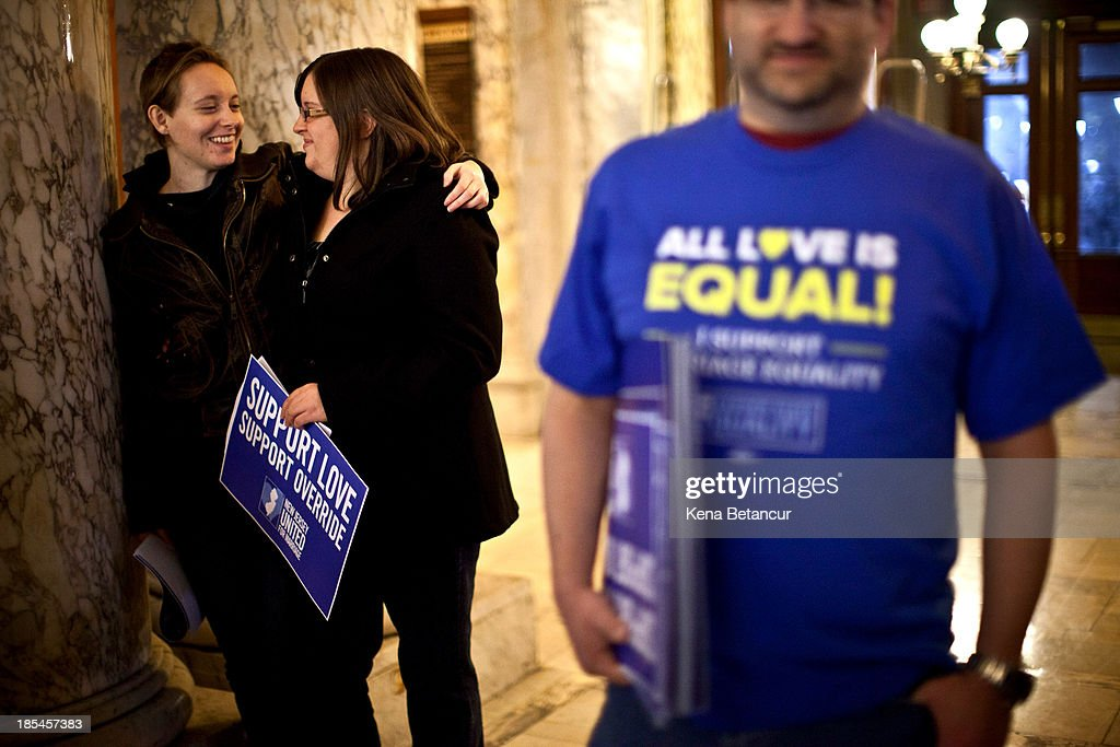 Lauren (R) and Katelynn hug each other as they attend the first massive gay wedding ceremonies at City Hall in the early morning hours of October 21, 2013 in Newark, New Jersey. Same-sex couples were allowed to legally wed at 12:01 am on Monday across New Jersey, making the state the 14th to allow same-sex marriages. Following Friday's ruling by the New Jersey Supreme Court, Mayor Cory A. Booker will marry seven gay, lesbian, and straight couples at City Hall in Newark on Monday morning.