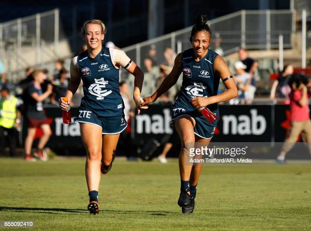 Lauren Arnell and Darcy Vescio of the Blues during the 2017 AFLW Round 07 match between the Carlton Blues and the Brisbane Lions at Ikon Park on...