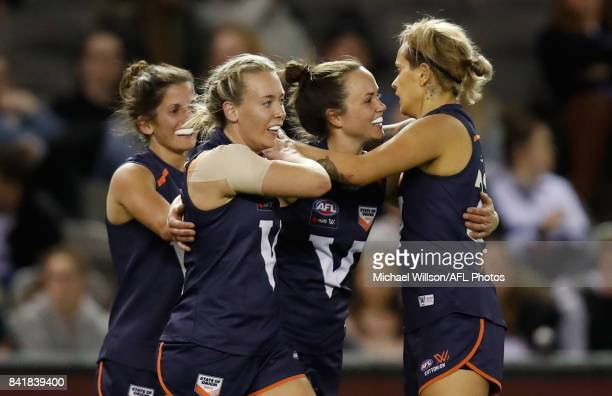 Lauren Arnell Daisy Pearce and Moana Hope of Victoria celebrate during the AFL Women's State of Origin match between Victoria and the Allies at...