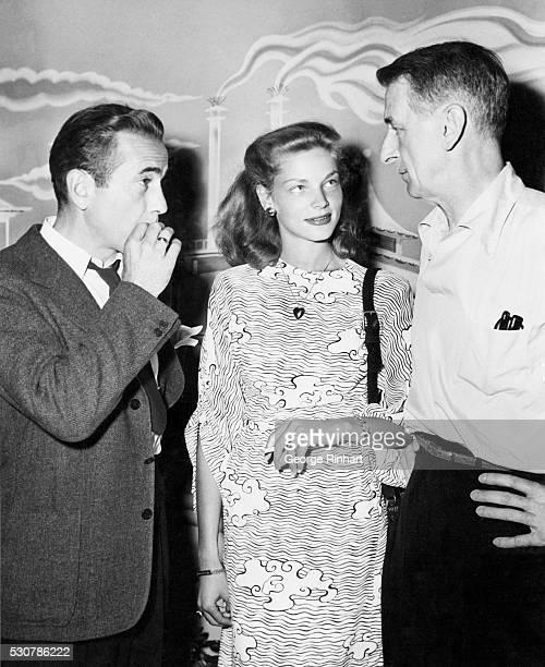 Lauren Bacall visits her husband Humphrey Bogart and director John Cromwell between scenes of Columbia's Dead Reckoning The film stars Bogart and...