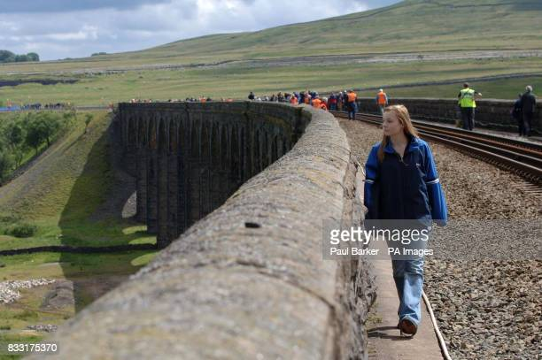 Lauren Barker along with hundred's of other people make the most of today's once in a life time opportunity to walk across the Ribblehead Viaduct on...
