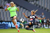 Lauren Barnes of the Victory kicks the ball as Stephanie Ochs of Canberra applies pressure during the round seven WLeague match between Melbourne and...