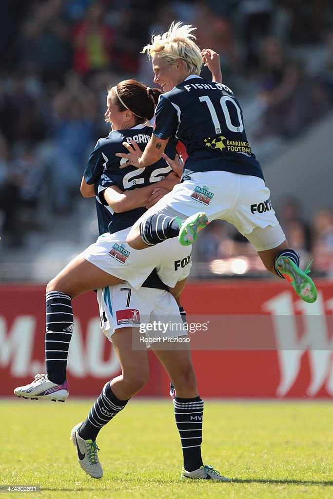 Lauren Barnes of Victory celebrates with team-mates after scoring a goal during the W-League Grand Final match between the Melbourne Victory and the Brisbane Roar at Lakeside Stadium on February 23, 2014 in Melbourne, Australia.