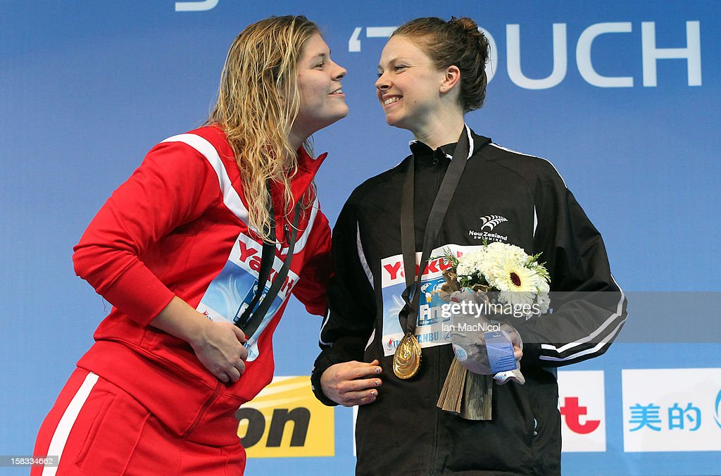 Lauren Boyle of New Zealand kisses Lotte Friis of Denmark as she poses with her Gold medal from the Women's 800m Freestyle during day two of the FINA World Short Course Swimming Championships on December 13, 2012 in Istanbul, Turkey.