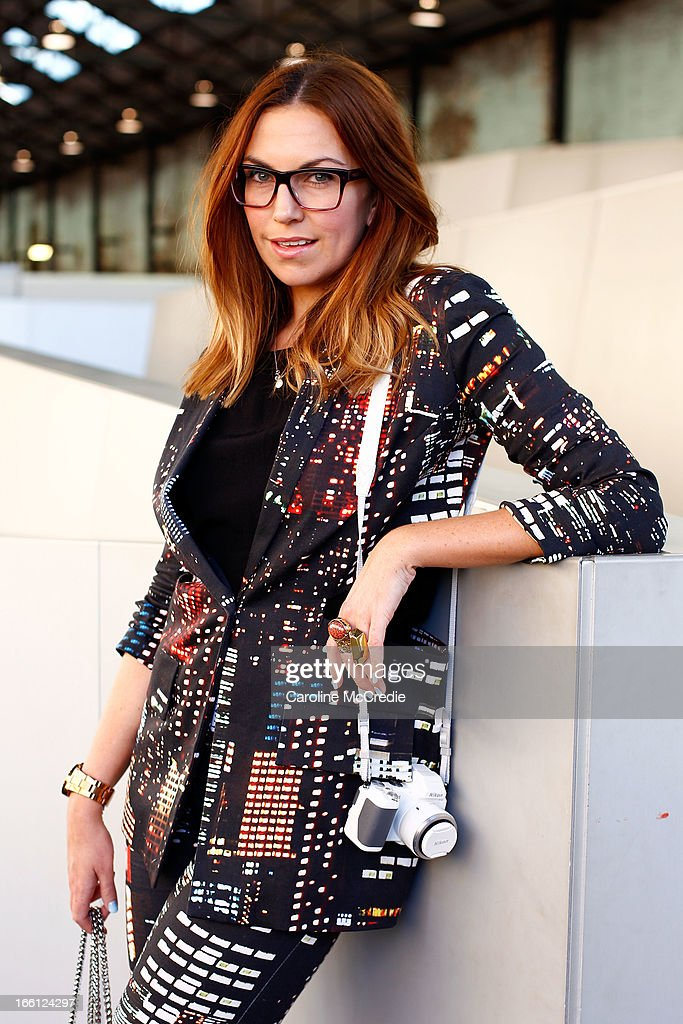 Lauren Brain wears a Jollet outfit, rings by YSL and carries a bag by Dylan Kane at Mercedes-Benz Fashion Week Australia Spring/Summer 2013/14 at Carriageworks on April 9, 2013 in Sydney, Australia.