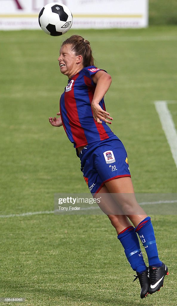Lauren Brown of the Jets heads the ball during the round five W-League match between the Newcastle Jets and Canberra United at Wanderers Oval on December 14, 2013 in Newcastle, Australia.