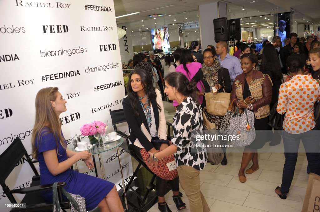 Lauren Bush Lauren and Rachel Roy speak with attendees as Roy debuts FEED India Collaboration with Lauren at Bloomingdale's 59th Street Store on May 9, 2013 in New York City.