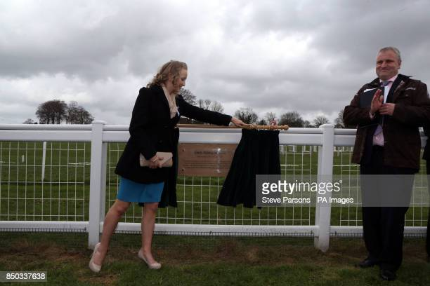 Lauren Caisley with Rupert Trevelyan MD for Epsom racecourse unveil a Plaque for suffragette Emily Davison at Tattenham Corner at Epsom Downs...