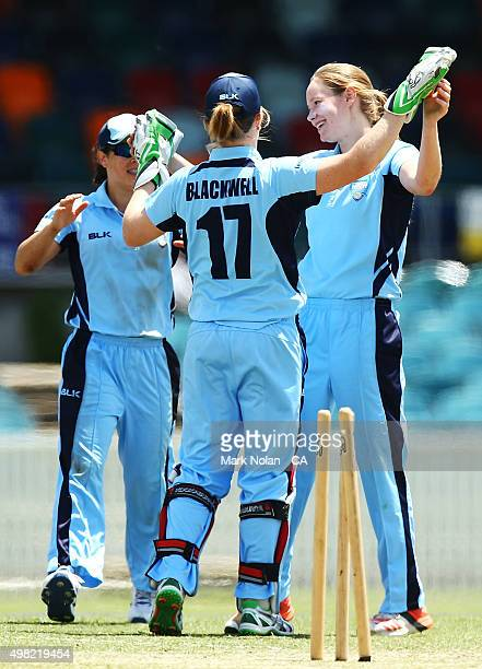 Lauren Cheatle of the Breakers celebrates a wicket during the WNCL match between the Victoria Spirit and the New South Wales Breakers at Manuka Oval...