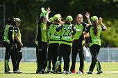 Lauren Cheatle of the Thunder celebrates with team mates after taking the wicket of Sara McGlashan of the Sixers during the Women's Big Bash League...