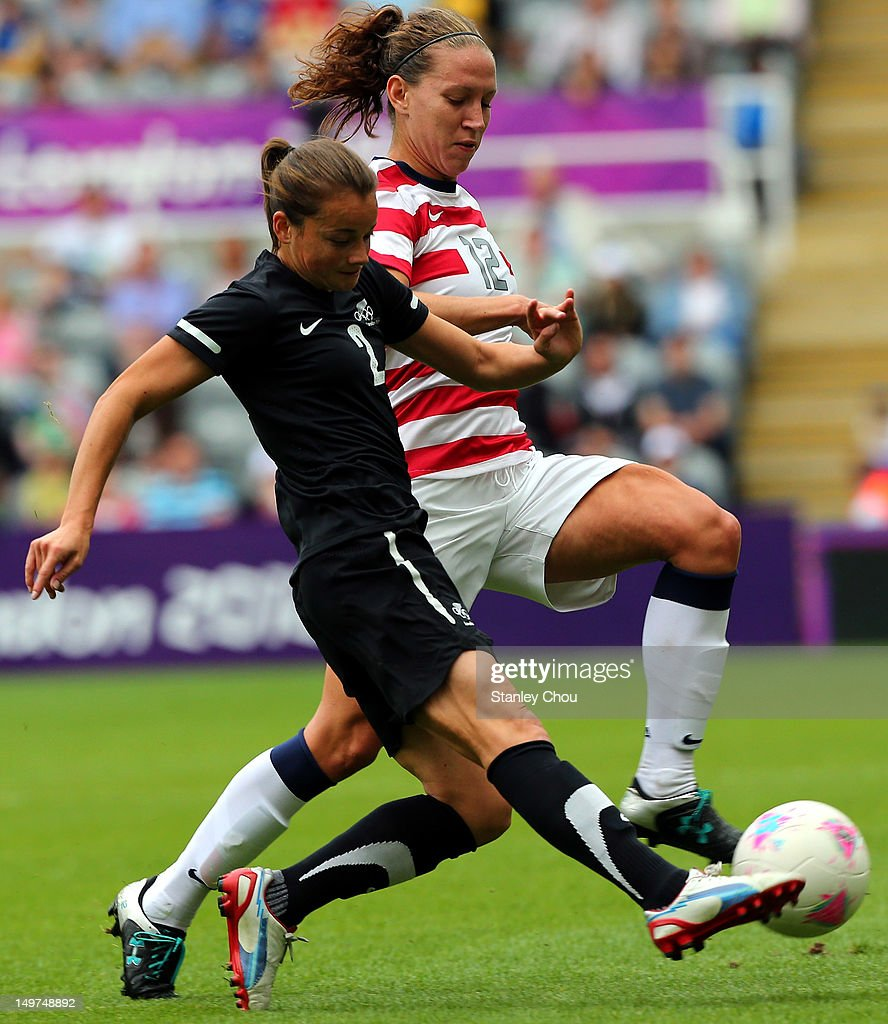 Lauren Cheney of the United States battles with Ria Percival of New Zealand during the Women's Football Quarter Final match between United States and New Zealand, on Day 7 of the London 2012 Olympic Games at St James' Park on August 3, 2012 in Newcastle upon Tyne, England.