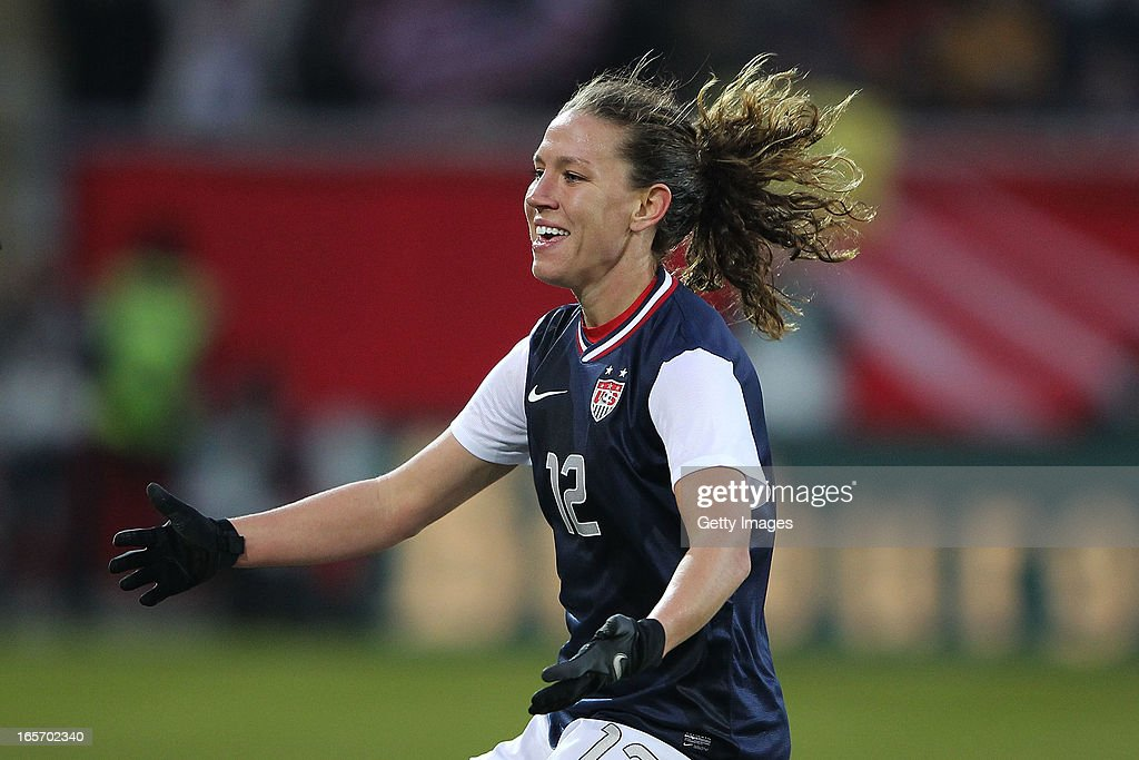 Lauren Cheney of the United States celebrates after her team's third goal is scored by team-mate Alex Morgan during the Women's International Friendly match between Germany and the United States at Sparda-Bank-Hessen-Stadion on April 5, 2013 in Offenbach, Germany.