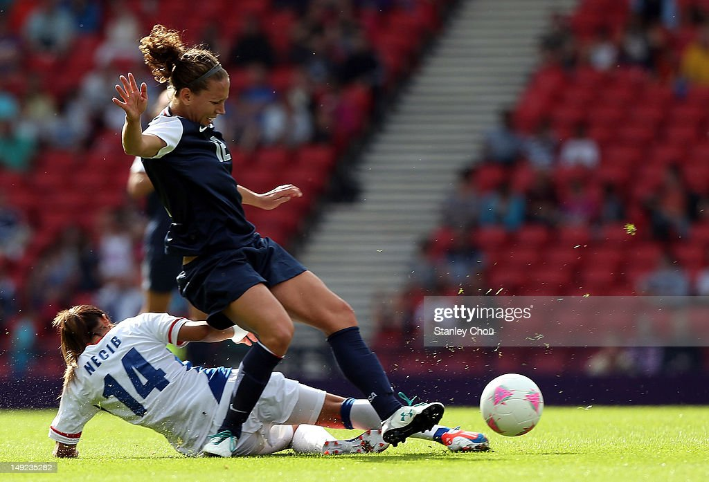 Lauren Cheney of USA is tackled by <a gi-track='captionPersonalityLinkClicked' href=/galleries/search?phrase=Louisa+Necib&family=editorial&specificpeople=2333059 ng-click='$event.stopPropagation()'>Louisa Necib</a> of France during the Women's Football first round Group G Match of the London 2012 Olympic Games between United States and France, at Hampden Park on July 25, 2012 in Glasgow, Scotland.