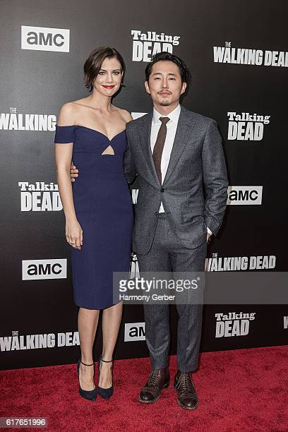Lauren Cohan and Stephen Yeun arrive at AMC presents live 90minute special edition of 'Talking Dead' at Hollywood Forever on October 23 2016 in...