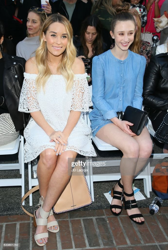 Lauren Conrad and Taissa Farmiga attend designer Rebecca Minkoff's Spring 2017 'See Now, Buy Now' Fashion Show at The Grove on February 4, 2017 in Los Angeles, California.
