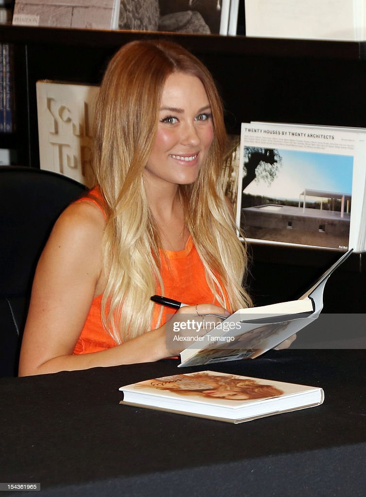 <a gi-track='captionPersonalityLinkClicked' href=/galleries/search?phrase=Lauren+Conrad&family=editorial&specificpeople=537620 ng-click='$event.stopPropagation()'>Lauren Conrad</a> greets fans and signs copies of her books 'Beauty' and 'Starstruck' at Books and Books on October 18, 2012 in Miami Beach, Florida.
