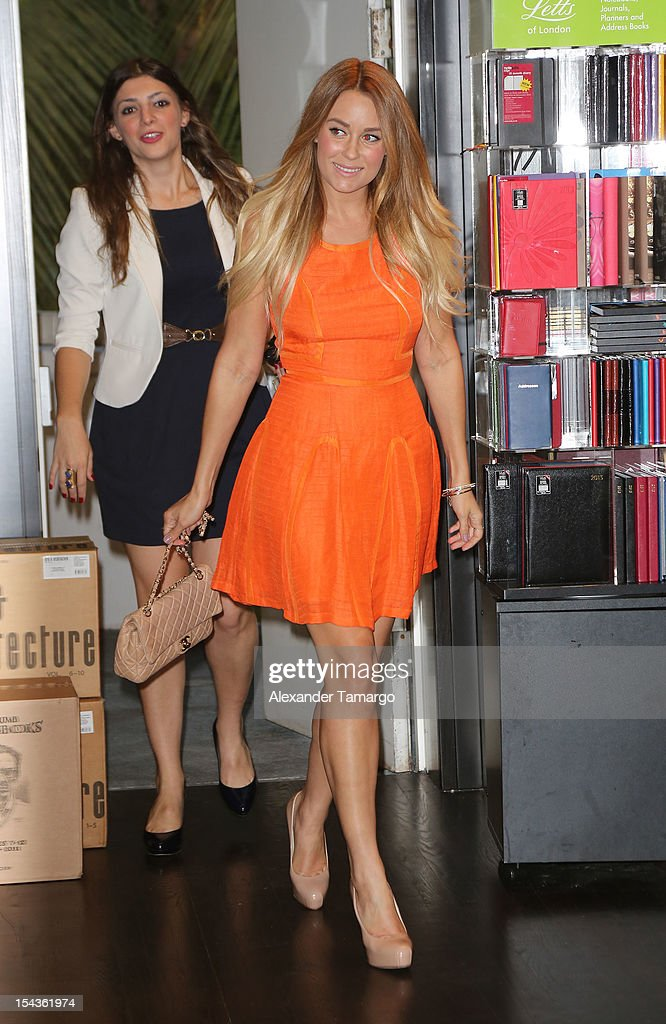 Lauren Conrad greets fans and signs copies of her books 'Beauty' and 'Starstruck' at Books and Books on October 18, 2012 in Miami Beach, Florida.