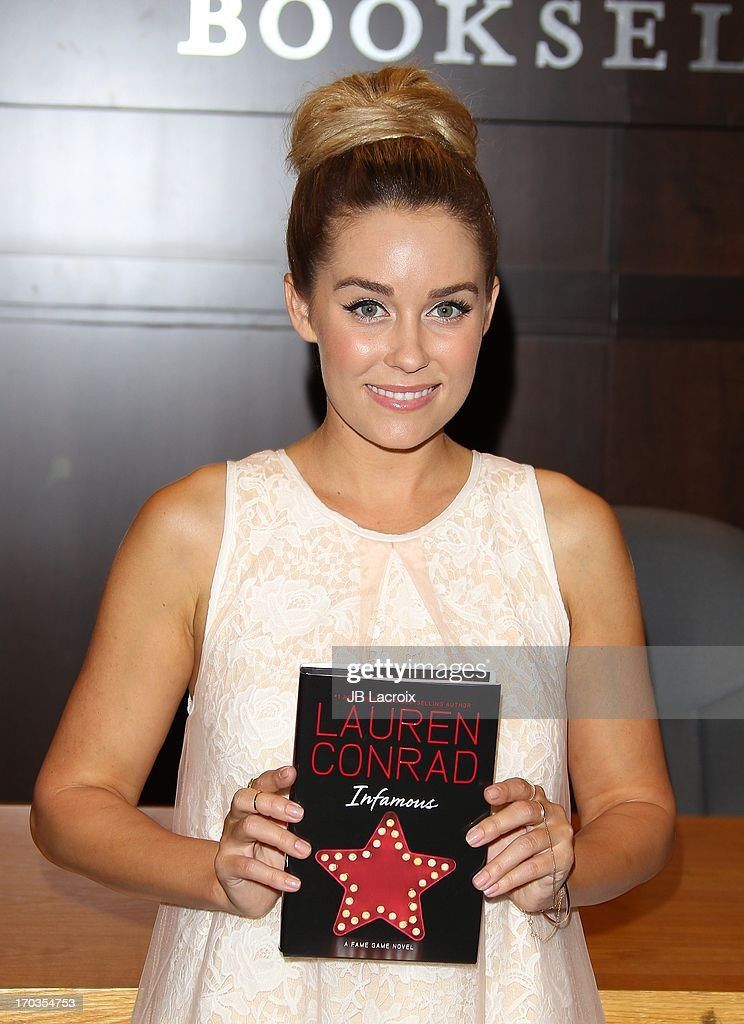 <a gi-track='captionPersonalityLinkClicked' href=/galleries/search?phrase=Lauren+Conrad&family=editorial&specificpeople=537620 ng-click='$event.stopPropagation()'>Lauren Conrad</a> signs copies of her new book 'Infamous' at Barnes & Noble bookstore at The Grove on June 11, 2013 in Los Angeles, California.