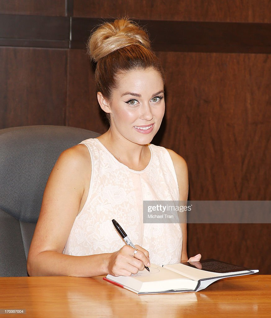 <a gi-track='captionPersonalityLinkClicked' href=/galleries/search?phrase=Lauren+Conrad&family=editorial&specificpeople=537620 ng-click='$event.stopPropagation()'>Lauren Conrad</a> signs copies of her new book 'Infamous' held at Barnes & Noble bookstore at The Grove on June 11, 2013 in Los Angeles, California.