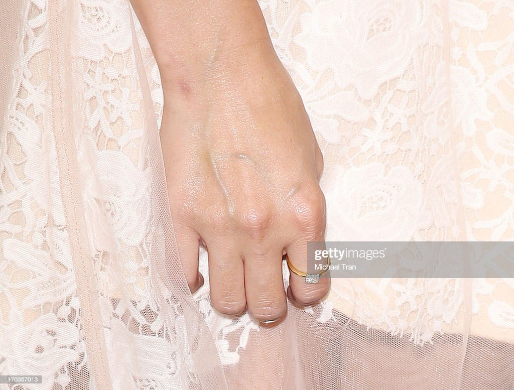 <a gi-track='captionPersonalityLinkClicked' href=/galleries/search?phrase=Lauren+Conrad&family=editorial&specificpeople=537620 ng-click='$event.stopPropagation()'>Lauren Conrad</a> (ring detail) signs copies of her new book 'Infamous' held at Barnes & Noble bookstore at The Grove on June 11, 2013 in Los Angeles, California.