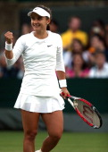 Lauren Davis of the United States celebrates after winning her Ladies' Singles second round match against Flavia Pennetta of Italy on day three of...