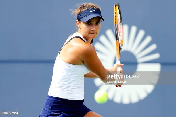 Lauren Davis of the United States returns a shot to Eugenie Bouchard of Canada during Day 4 of the Connecticut Open at Connecticut Tennis Center at...