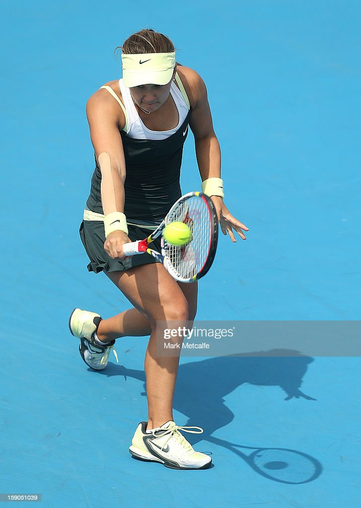Lauren Davis of USA plays a backhand in her first round match against Bojana Bobusic of Australia during day four of the Hobart International at Domain Tennis Centre on January 7, 2013 in Hobart, Australia.