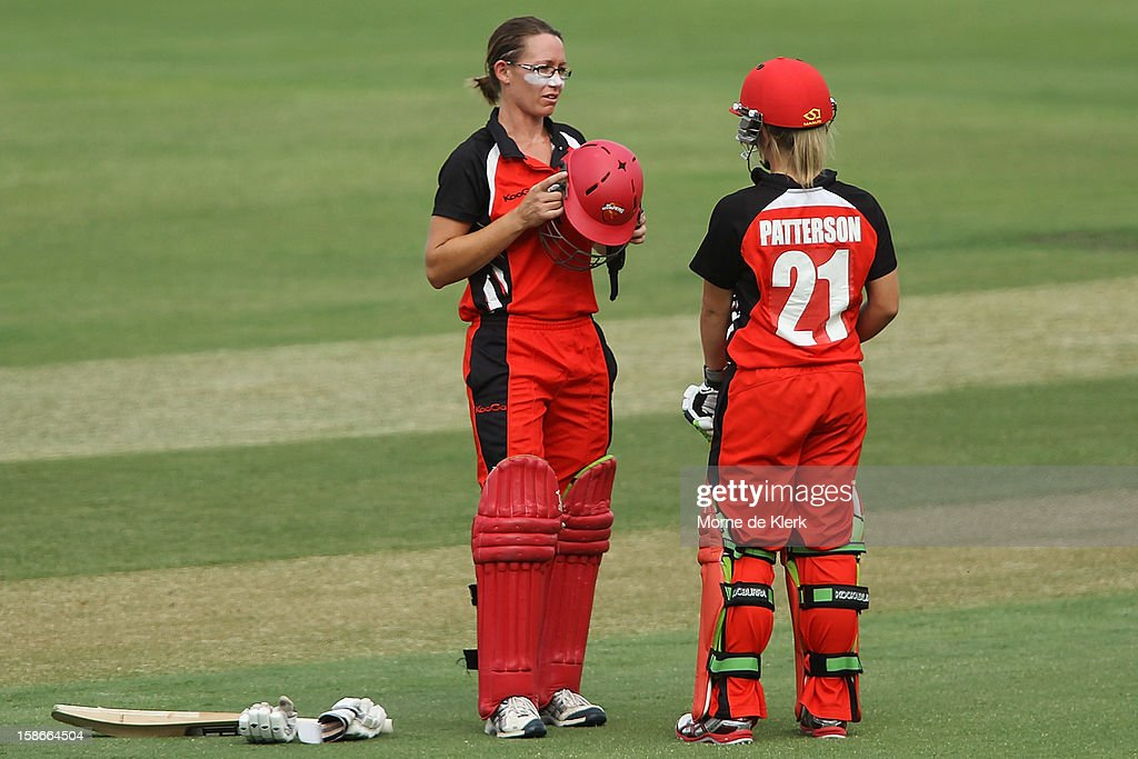 Lauren Ebsary and Bridget Patterson of of the Scorpions talk between overs during the women's twenty20 match between the South Australia Scorpions and the New South Wales Breakers at Adelaide Oval on December 23, 2012 in Adelaide, Australia.