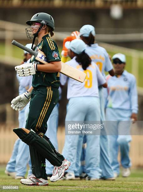 Lauren Ebsary of Australia walks back to the pavillon after being dismissed by Seema Pujare of India during the third women's one day international...