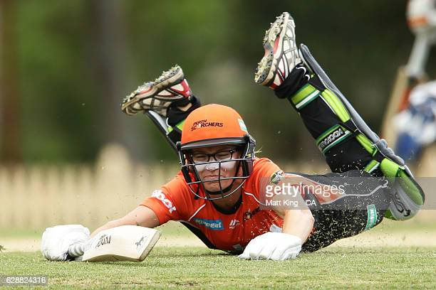 Lauren Ebsary of the Scorchers slides in to avoid a runout during the Women's Big Bash League match between the Hobart Hurricanes and the Perth...