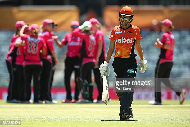 Lauren Ebsary of the Scorchers walks back to the dug out after being runout by Marizanne Kapp of the Sixers during the Women's Big Bash League match...
