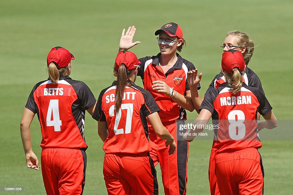 Lauren Ebsary of the Scorpions celebrates with team mates after a breakers wicket went down during the women's twenty20 match between the South Australia Scorpions and the New South Wales Breakers at Adelaide Oval on December 23, 2012 in Adelaide, Australia.