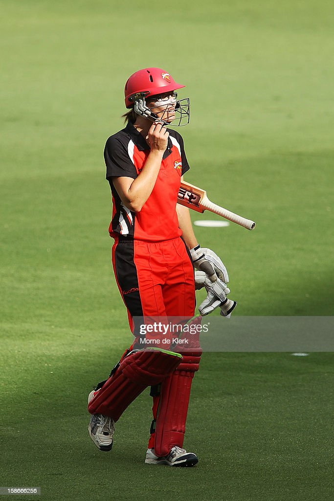 Lauren Ebsary of the Scorpions leaves the field after getting out during the women's twenty20 match between the South Australia Scorpions and the New South Wales Breakers at Adelaide Oval on December 23, 2012 in Adelaide, Australia.