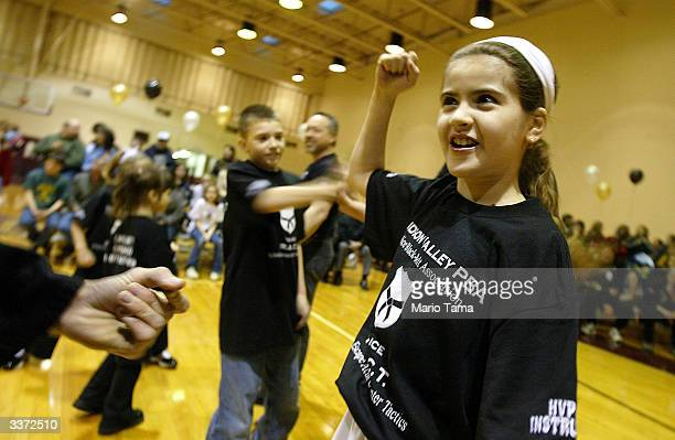 Lauren Espinoza practices selfdefense tactics during a Carlie's Crusade REACT class in defense tactics primarily for girls April 14 2004 in Cornwall...